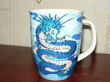 Mug with a blue dragon by Dokatamaru Sorex Digger Shrew.JPG